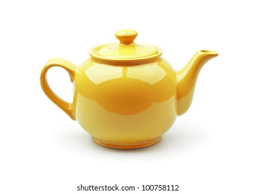 Bright orange teapot isolated on white background