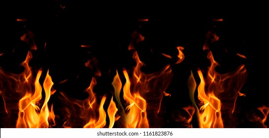 bright orange and yellow flames on a black background,close up, banner