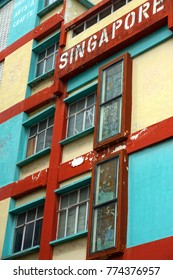 Bright paint peels off an old fashioned building