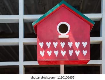 Bright painted decorative birdhouse. Horizontal close-up