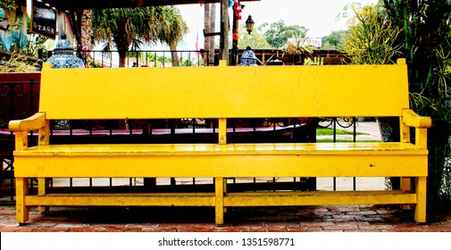 Bright painted yellow wooden bench
