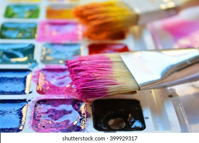 bright paints and artist brushes