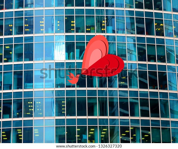 Bright photo background. Geometric glass wall and bird in love