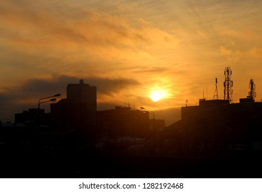 Bright photo background sunset sky in the city in the evening