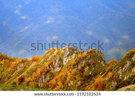 Bright photo of a beautiful autumn landscape with mountains and hills