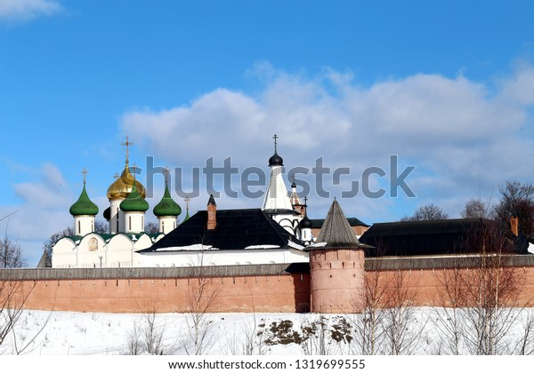 Bright photos of the ancient fortress of the Orthodox monastery of Suzdal in winter is illuminated by the sun