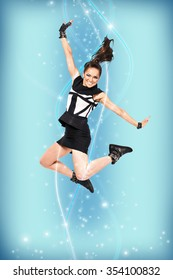Bright picture of happy jumping attractive woman on the blue background