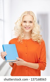 bright picture of happy and smiling woman with book