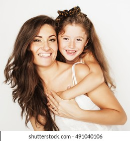 bright picture of hugging mother and daughter happy together isolated on white background, smiling stylish family. lifestyle people concept