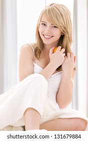 bright picture of lovely blonde with oranges