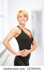 bright picture of lovely fitness instructor in gym