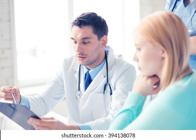 bright picture of male doctor with patient