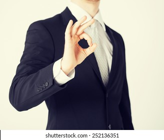 bright picture of man hands showing ok sign