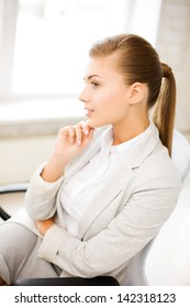 bright picture of pensive woman in office