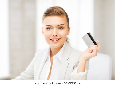 bright picture of smiling businesswoman showing credit card