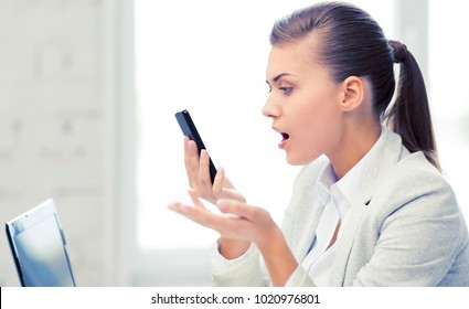 bright picture of woman shouting into smartphone