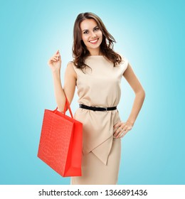 Bright picture of young woman with red shopping bag, against blue-green background