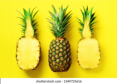 Bright pineapple pattern for minimal style. Top View. Pop art design, creative concept. Copy Space. Fresh pineapples on yellow background