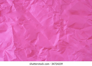 Bright pink crumpled paper (as a background)