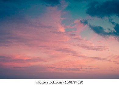 Bright pink and light blue sky with couple of clouds on a sunset