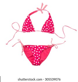 Bright pink swimsuit in white polka dots isolated on white background