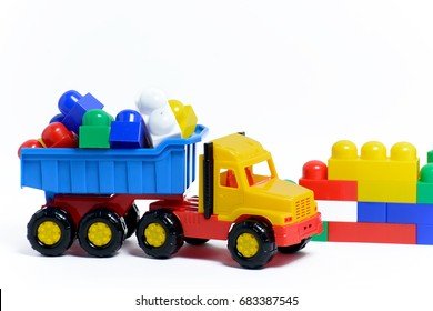 Bright plastic toy truck on white background