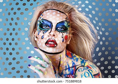 Bright pop art portrait of a sexy young cheerful girl on colorful background. Makeup. Blue background
