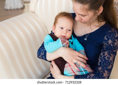 bright portrait of adorable baby boy and his mother