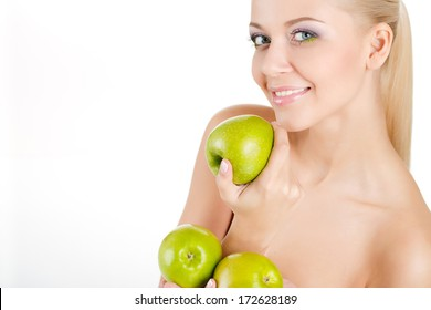 bright portrait of cheerful blonde woman with green apples on white background