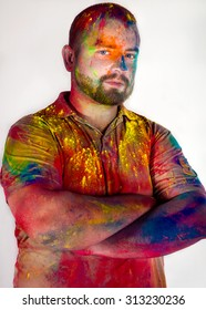 Bright positive man in holi paints