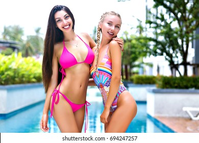 Cute teen trio in a pool