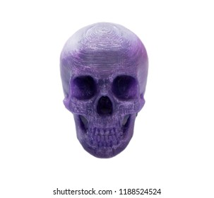 Bright purple object in shape of human skull toy printed on 3d printer isolated on white background. Fused deposition modeling, FDM. Concept modern progressive additive technology for 3d printing