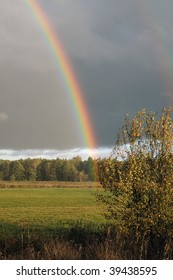 Bright rainbow after an autumn thunder-storm