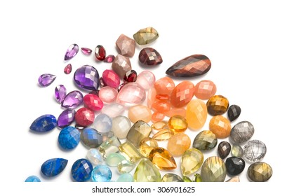 Bright real gemstones on the white background. Many different colorful precious and semiprecious gems.