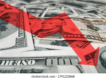 The bright red arrow icon on a background of money. The concept of changing course of US dollar on the market. Devaluation, collapse, stagnation of the economy owing to Quarantine coronavirus covid-19