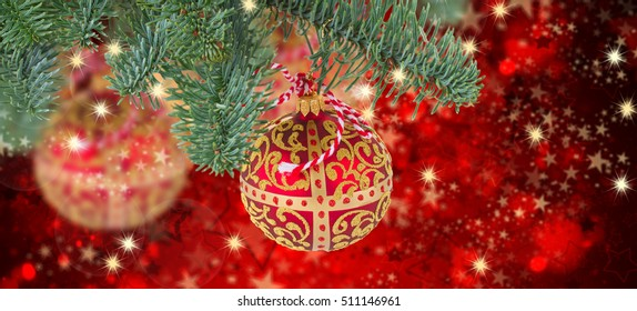 bright red  ball hanging on evergreen tree on  christmas red background