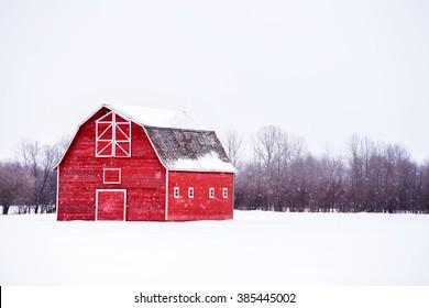 Bright red barn in white winter landscape