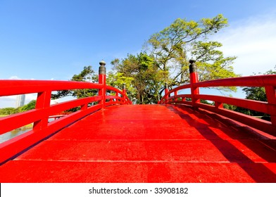 Bright red bridge in Singapore Chinese Garden