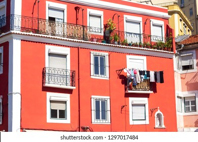 Bright red building facade in Alfama area, in Lisbon, Portugal