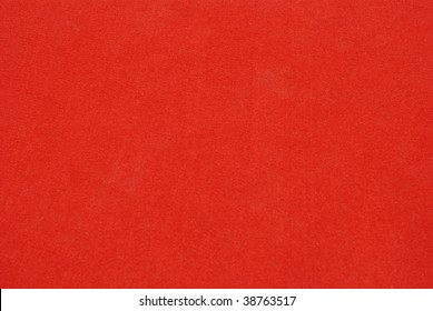The bright red carpet background.
