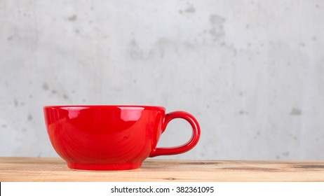 Bright red cup of tea.