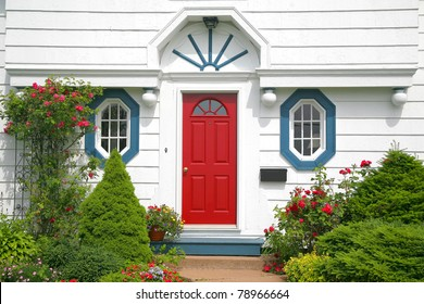 A bright red door on the entrance of a home.