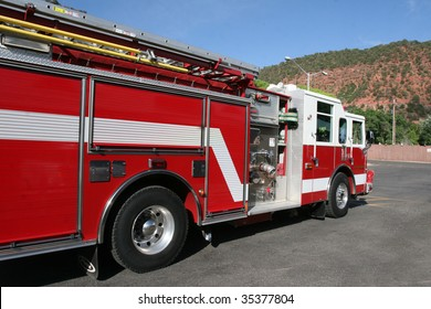 Bright red fire engine used to respond to emergency in mountain town.