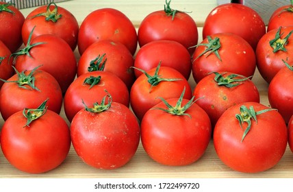Bright red garden tomatoes are being sold at a farmer market