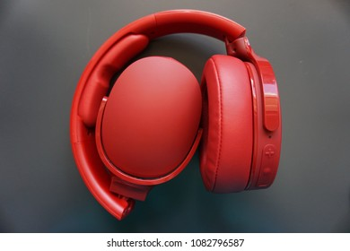 Bright red headphones for listening for music and audio/audible sounds.