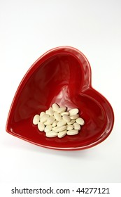 Bright red heart and medicines