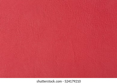 Bright red leather background. High resolution photo.