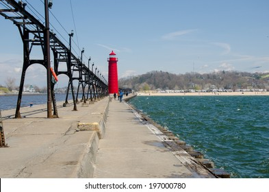 The bright red lighthouse by the Grand Haven beach