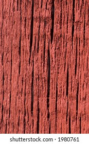 Bright red paint on weathered barn board. - Shutterstock ID 1980761