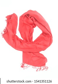 Bright red pashmina scarf with tassels arranged to show it off at its best. A silk and pashmina scarf pictured to sell.